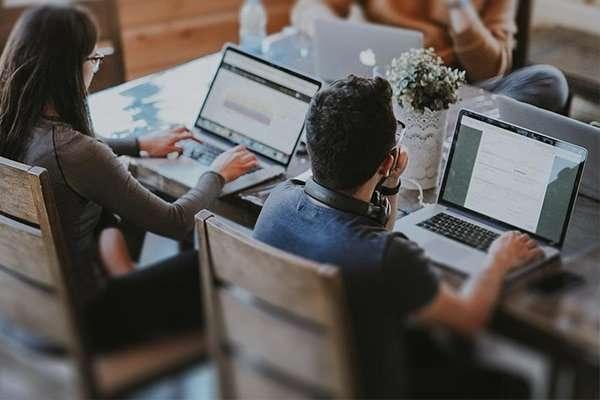 Image of Web designer and a web developer building a website at creative htx